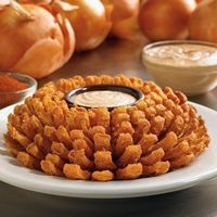 Outback Steakhouse Offers Fans Tasty Reason to Cheer for Newman