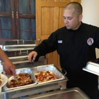 Shawn Randazzo serving samples of his world champion pizza recipes.