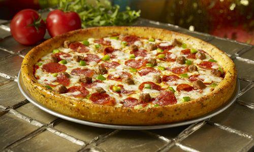 Pizza Inn Adds Garlic Bread Crust Pizza to Its Menu