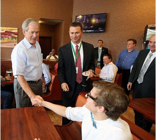 Former President George W. Bush Shares a Sandwich, Advice With Carroll Senior High Students