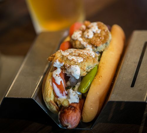 JJ's Red Hots Helps 1060 Creative Celebrate its 10th Anniversary with a World-Class Hot Dog Named in its Honor