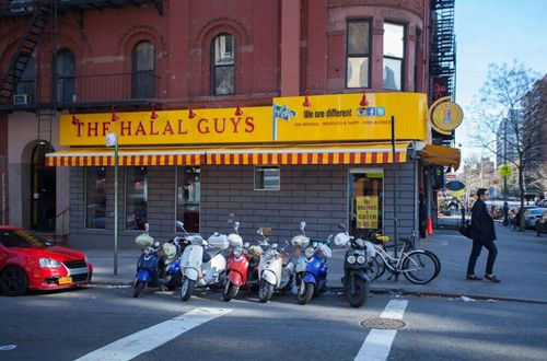 The famous never-ending line at The Halal Guys food cart