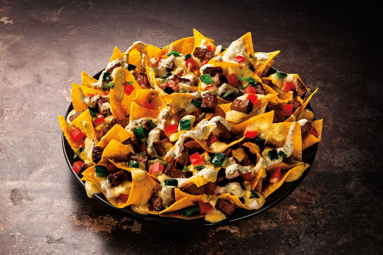Taco John's Adds Sirloin Steak Nachos To Signature Menu