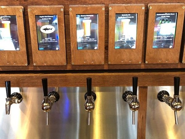 Crave Hot Dogs and BBQ Features Self-Serve Beer Wall!