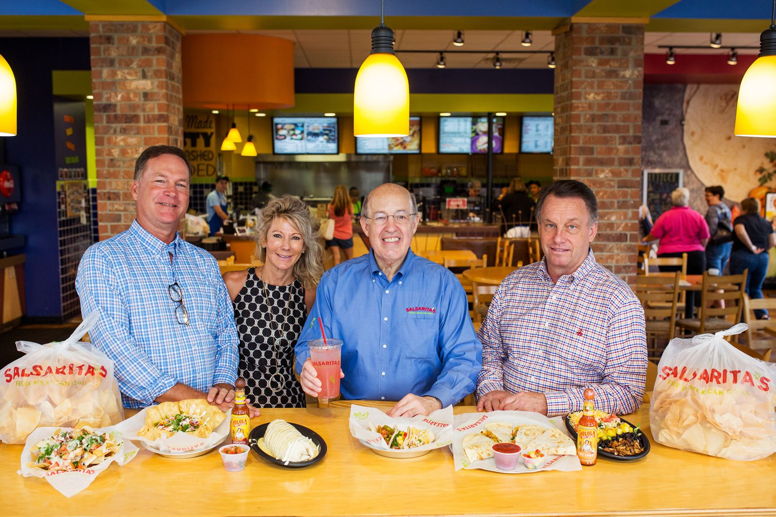 Steve Stallings, Pam Stallings, Phil Friedman President and CEO of Salsarita's Fresh Mexican Grill and Ken Green COO.
