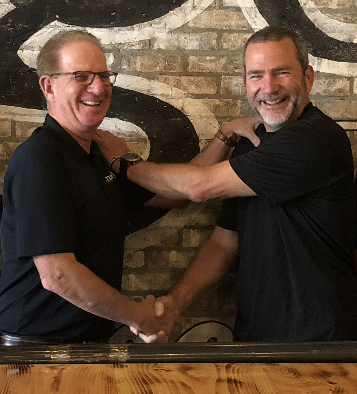 Huey Magoo's President-CEO Andy Howard & Atlanta Franchisee Dean Thompson.