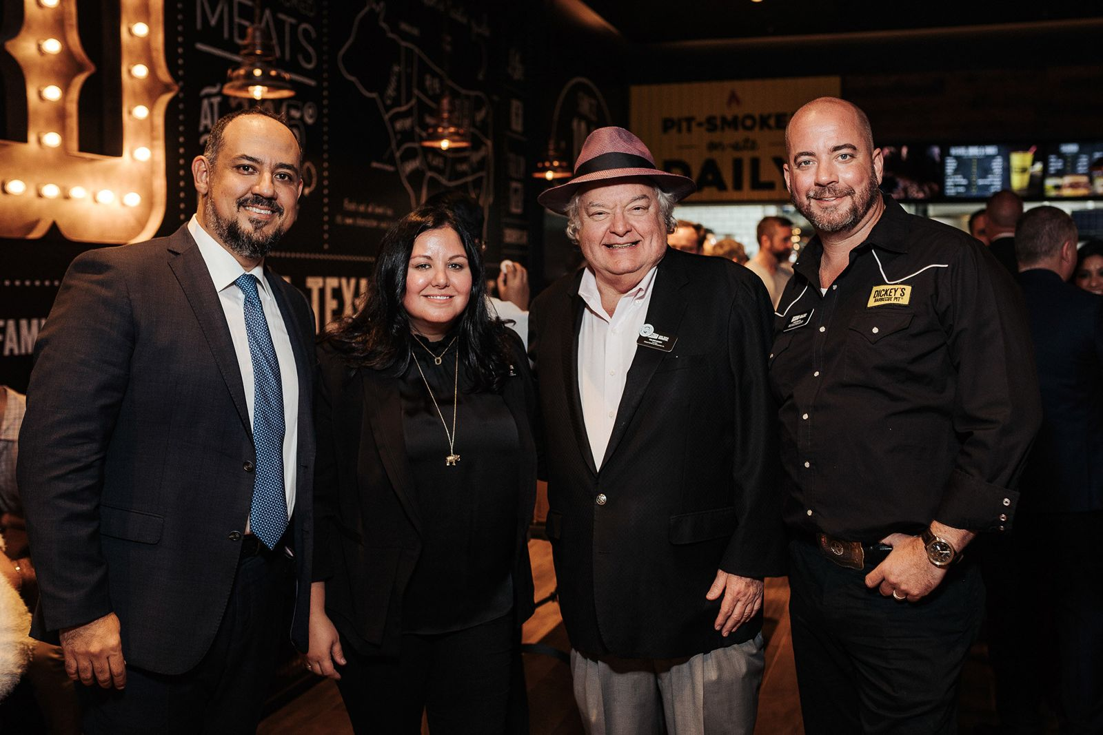 Laura Rea Dickey, CEO of Dickey's Barbecue Restaurants, Inc.; Mr. Dickey, Founder of Dickey's Barbecue Pit; Chris Kelley, Dean of Barbecue University and Youssef El Habbal, CEO of Serenity Hospitality at the first Dickey's Barbecue Pit international opening in Abu Dhabi.