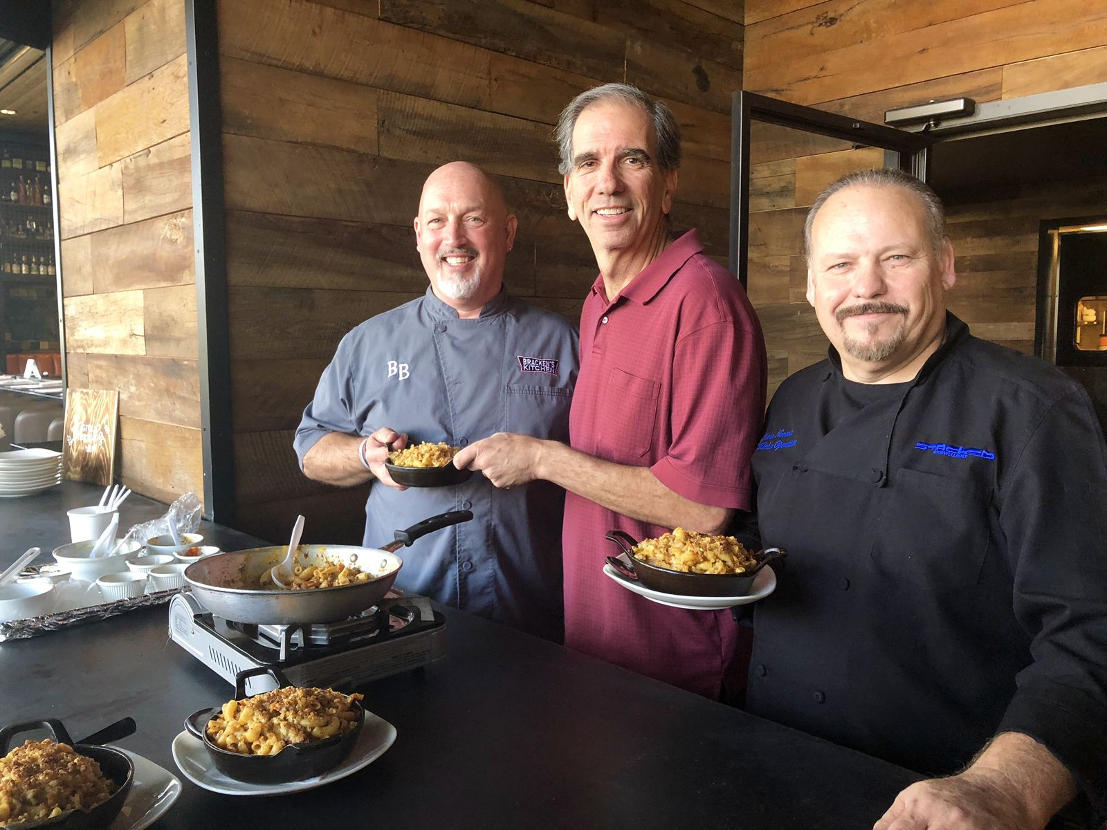 From left, Chef Bill Bracken, Paul Motenko, co founder and co CEO of STACKED, and Javier Navarro, executive chef at STACKED.