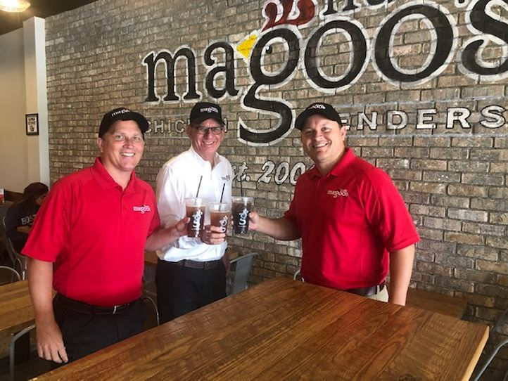 Huey Magoo's James Connolly, President and CEO Andy Howard, and Bryan Pagan