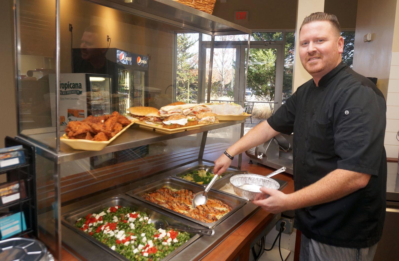 Joe Guditus serving a customer favorite, teriyaki salmon.