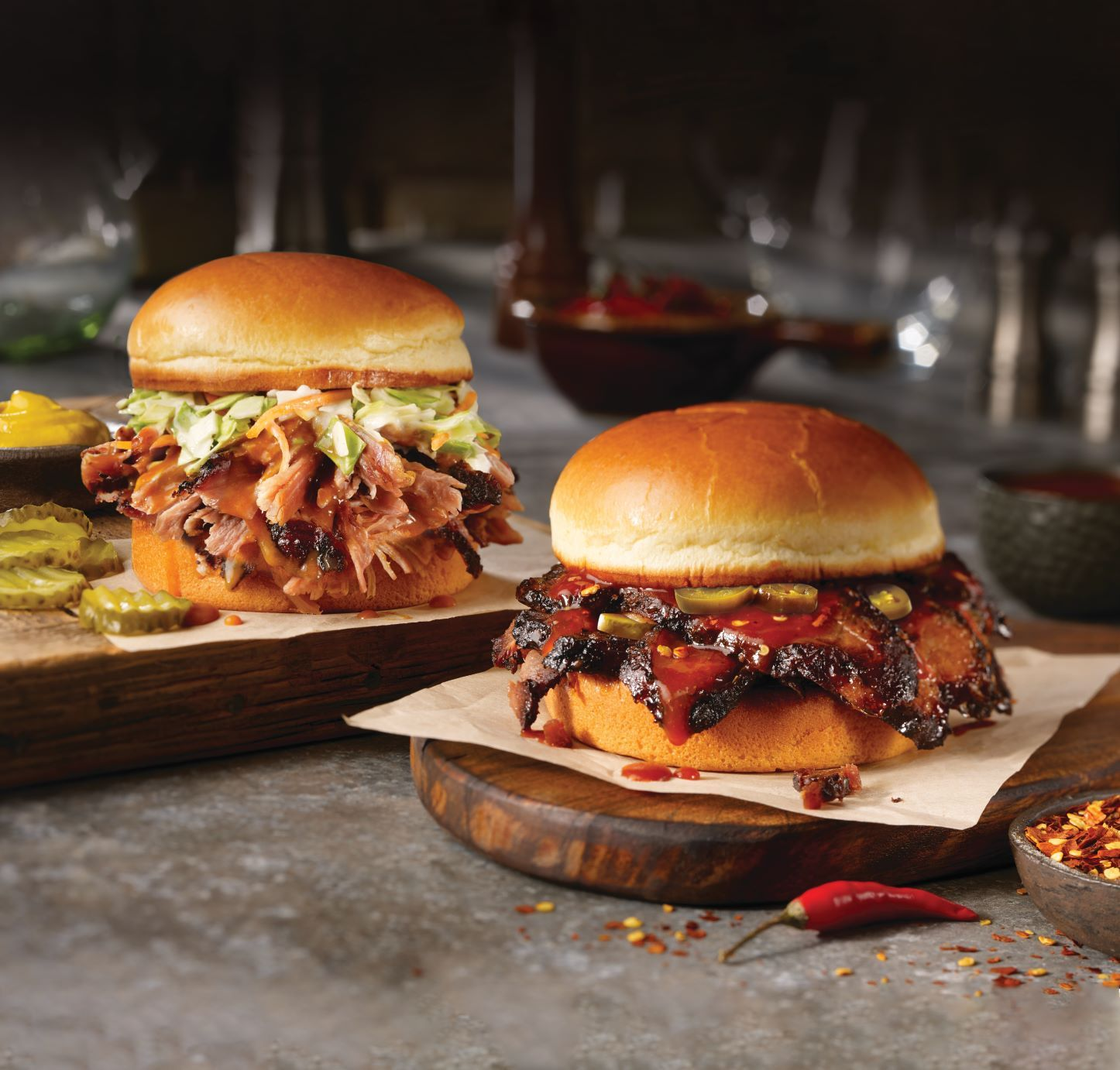 Dickey's new Texas Hot Brisket Sandwich is loaded with Texas-style brisket and topped with Texas hot barbecue sauce and jalapenos in between a warm brioche bun. The Carolina Style Pulled Pork Sandwich is Dickey's sweet and tangy twist on a barbecue staple that includes Dickey's famous hickory-smoked pulled pork topped with Carolina Barbecue Sauce and cole slaw on a warm brioche bun.