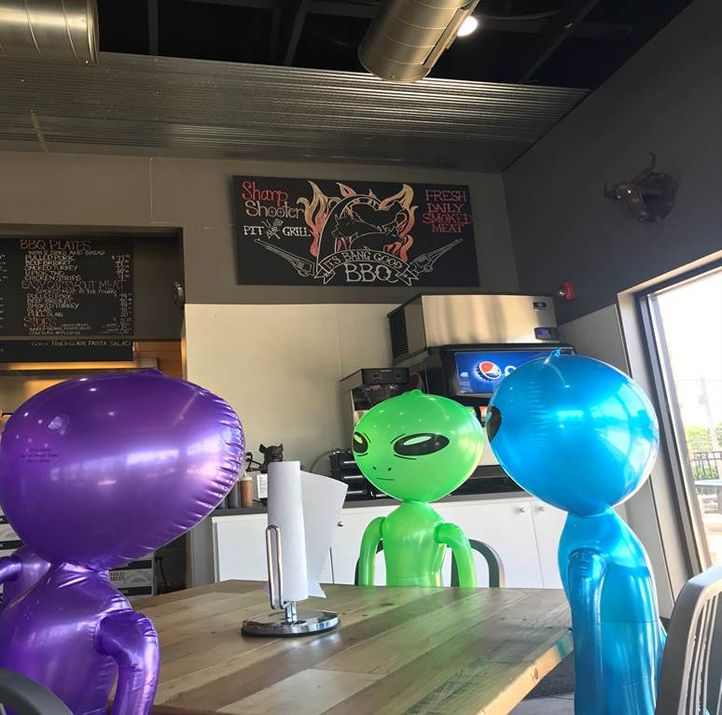 Aliens Supporting Social Distancing at Sharpshooter Pit & Grill All in Guests Delight