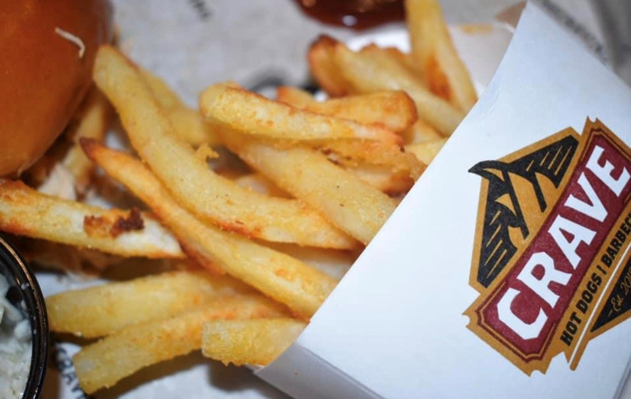 Crave Hot Dogs and BBQ celebrates National French Fry Day with FREE fries for all!