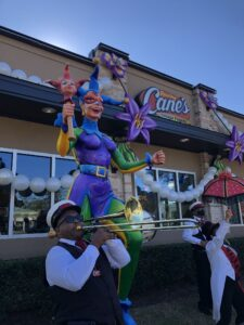 "Raising Cane's St. Charles Avenue Restaurant Celebrates ""Yardi Gras"""