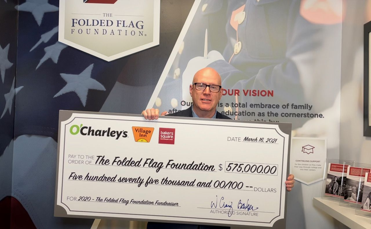 O'Charley's CEO Craig Barber presenting The Folded Flag Foundation with a check for $575,000.