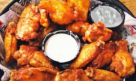 """In Honor of the Big Game This Weekend, Hurricane Grill & Wings Asks Football Fans the Age-Old Question: """"What's the Best Dip for Your Chicken Wings? Ranch or Bleu Cheese"""""""