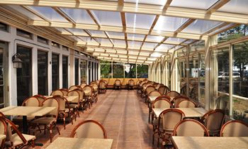 Invest in a Roll-A-Cover Retractable Enclosure for Your Restaurant Patio