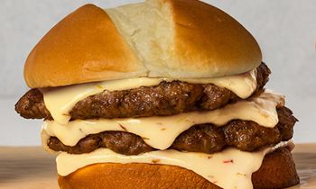 "Wayback Burgers Celebrates National Cheeseburger Day with ""Cheeeesy Quarantini"" Burger"